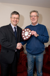 Ian Drew, editor of Frome Times presents the Person of the Year shield to Tony Perry.