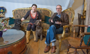 Helen Rowlinson with Evee the labradoodle,  Dolly the cockerpoo and Chris Moss with Byron the poodle.