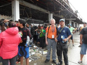 Mike Adams (left) in Tacloban.