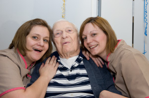 Tim with Rossetti House care home staff Kirstie Westlake and Fran Hillier.