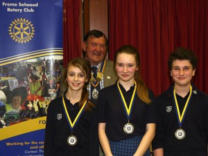 Above: The winning team of St Laurence School, l-r, the speaker Eleanor Cousins Brown (who also won the coveted Best Speaker Cup), the chairman Maia Campbell Lewis and Fin Robertson who gave the 'vote of thanks'. In the background is Frome Selwood Rotary Club's president Terry Candy