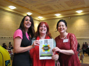 Jo Harrington (centre) who runs the Coffee Station with Amber Wagstaff-Summer (right) receiving the award from Lucy Siegle.