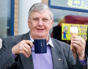 Derek enjoys a cup a char and an ice cream