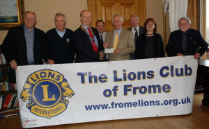 l-r, Lion Roger Windley, Lion David Naish, Lion president Frank Collins, Dr Chris Ellis, Chris Vincent  (Orchardleigh House) Philip Boon treasurer of WCS, Penny Old (office manager WCS) and Lion Clive Weeks.