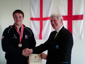 Ben Monksummers receives his medal from David Goodfellow chair of the English Small-bore Shooting Union (ESSU).