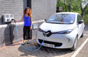 An electric car at a charging point.