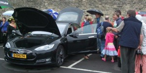 Residents take a look at the Tesla.