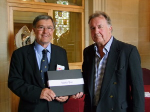 Martin Bax MBE receives his award.