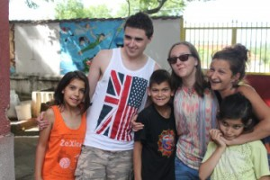 Students Chris Williams and Xenia Bibicoff-Crowley with children and staff from the orphanage.