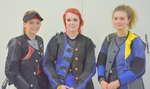 Amelia Dyer, centre, after her victory at the National Shooting Centre.