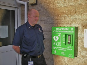 Station commander Phil Van Gorph  accepting a defibrillator on behalf of Frome Fire Station