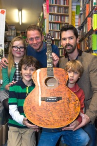 Alana Morales, Leander Morales, Sam Lakeman, Colm Lakeman and Noah Lakeman with the guitar
