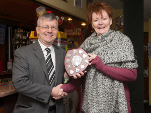 Ian Drew, editor of Frome Times presents the Person of the Year shield to Martina O'Connor.
