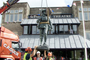 The statue of Charlie is lowered into position