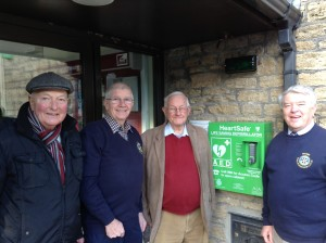 Rotary club members with a new defibrillator.