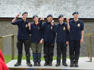 Members of Cadet Gilbert's Team receiving their medals : Left hand side, Cadet Gilbert, second left Corporal Mackenzie, far right Corporal Allen