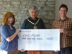 Mayor, Peter Macfadyen, presents the Fair Frome cheque to Matthew Thacker and Wendy Miller-Williams