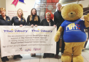The ball's organisers and sponsor Thornbury Sports at the RUH with Big Ted.